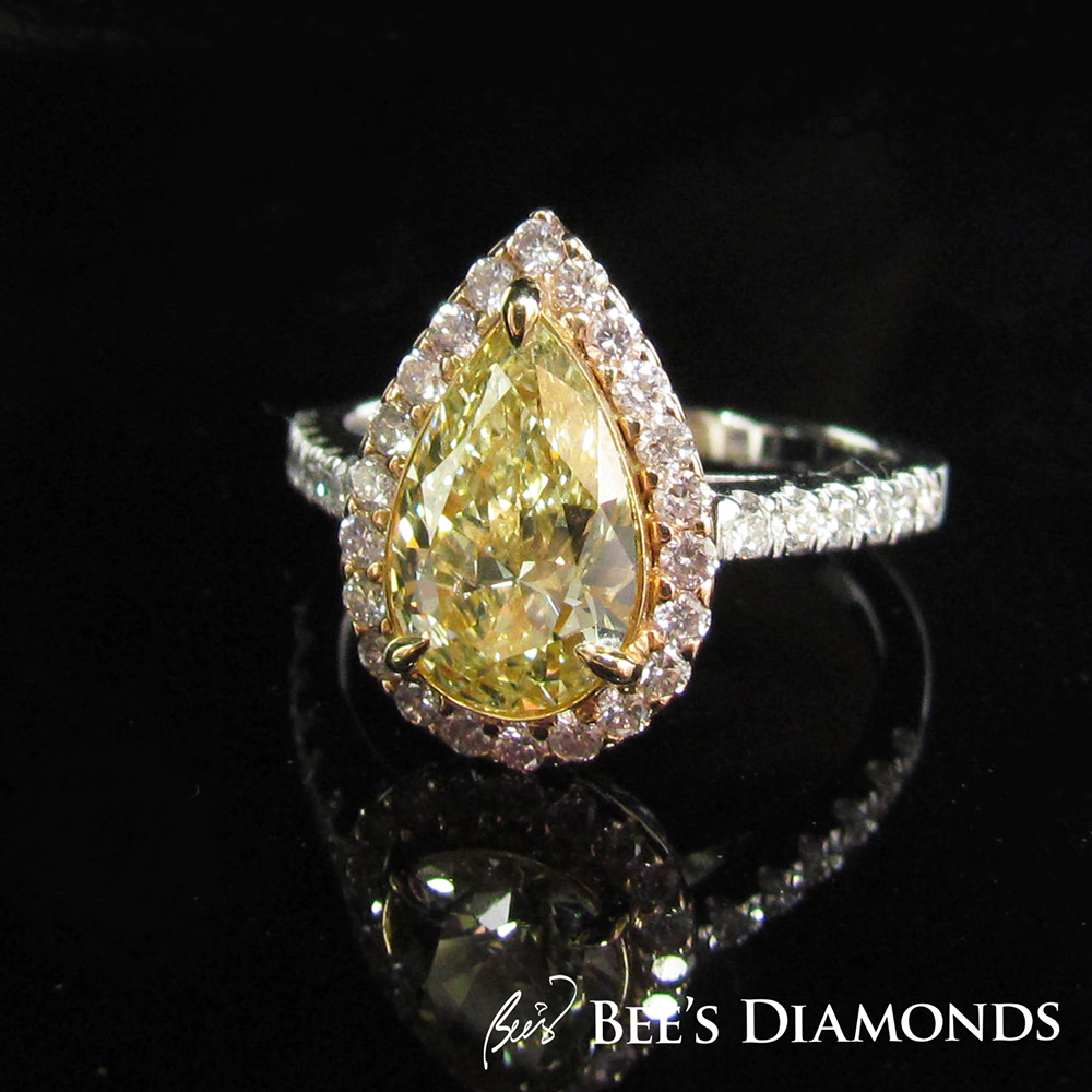 Fancy yellow pear shape diamond with pink diamonds ring