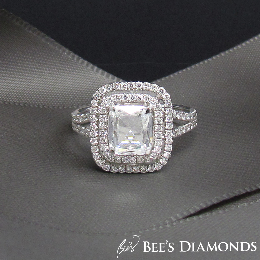 Rectangular, cushion, rose cut diamond ring with two halos of small diamonds