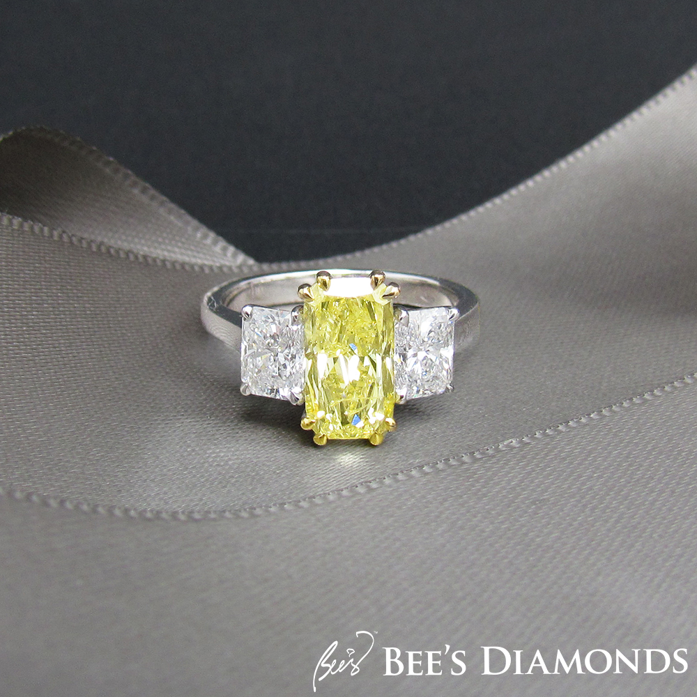 Long radiant cut, fancy yellow three stones diamond ring | tappered baguettes