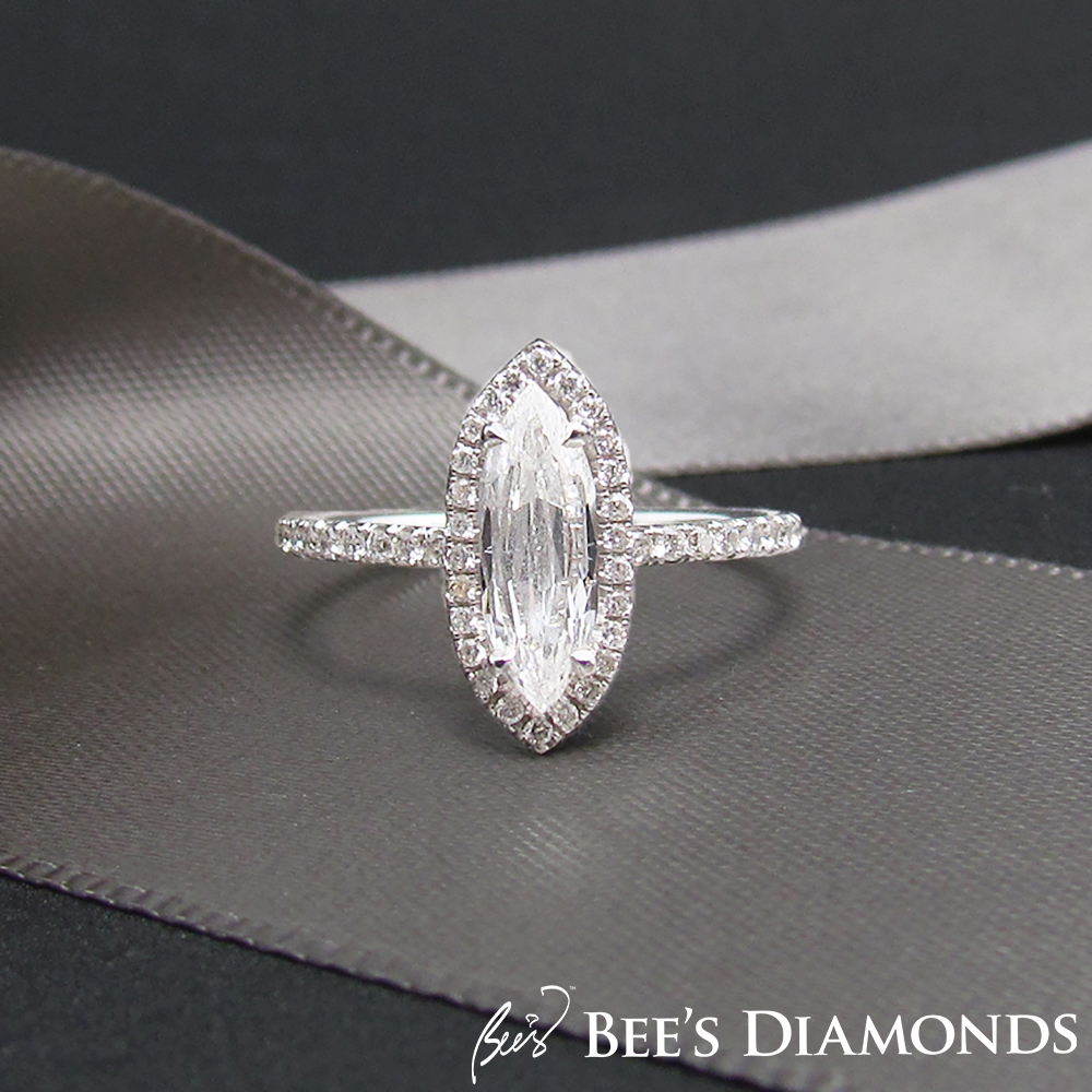 Marquise shape diamond engagement ring | Halo of small diamonds