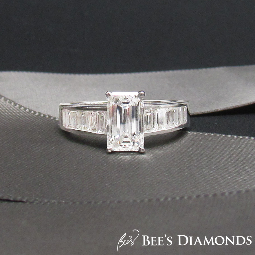 Crisscut diamond engagement ring with small baguettes