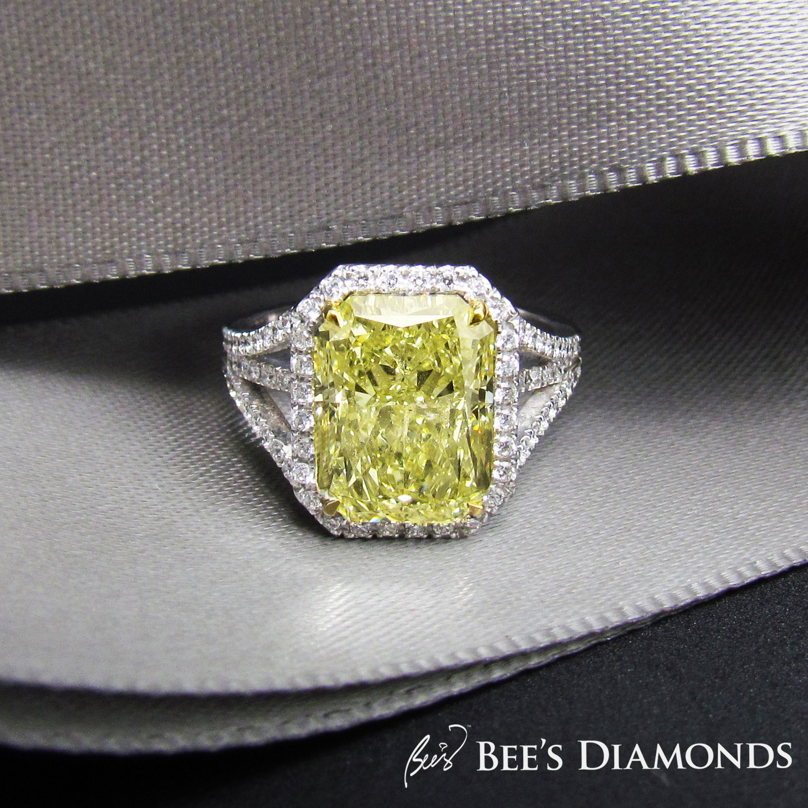 Large radiant cut fancy yellow diamond ring with GIA certificate