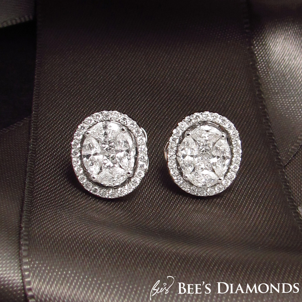 Invisible setting, large looking oval diamond earrings