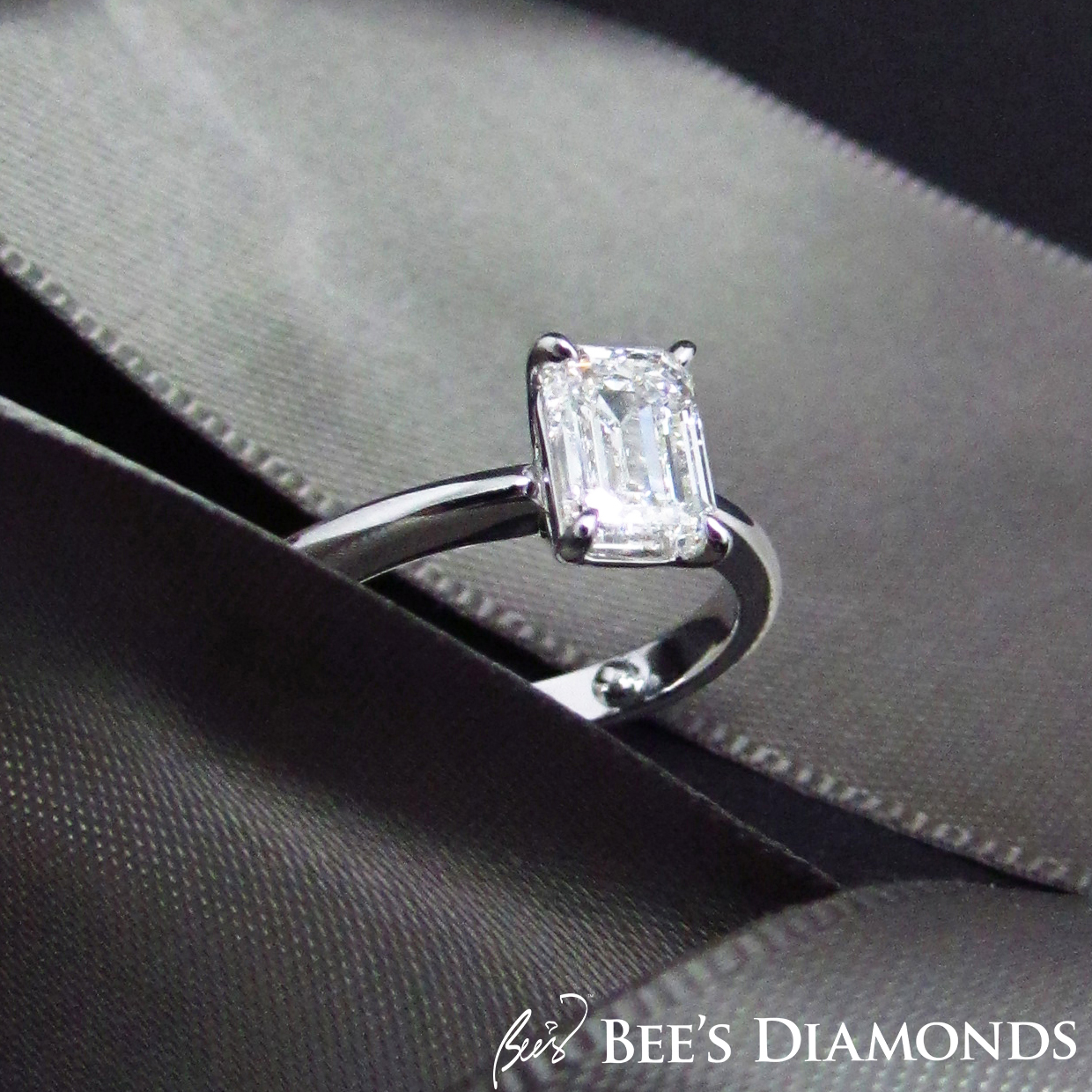 Emerald cut, simple elegant solitaire diamond engagement ring