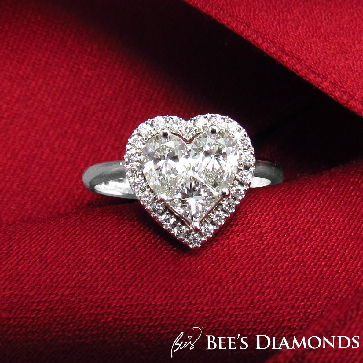Invisible setting, heart shaped diamond ring with halo