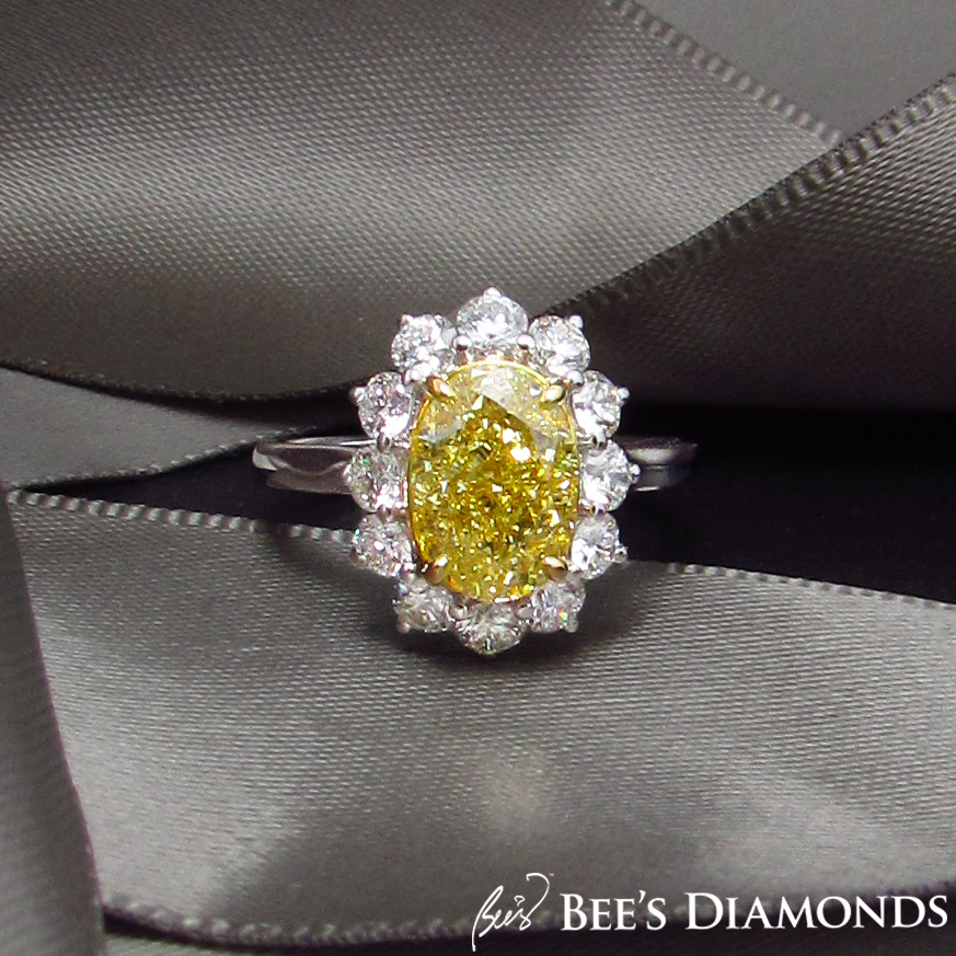 Oval, fancy yellow diamond ring, Sunflower shape engagement ring