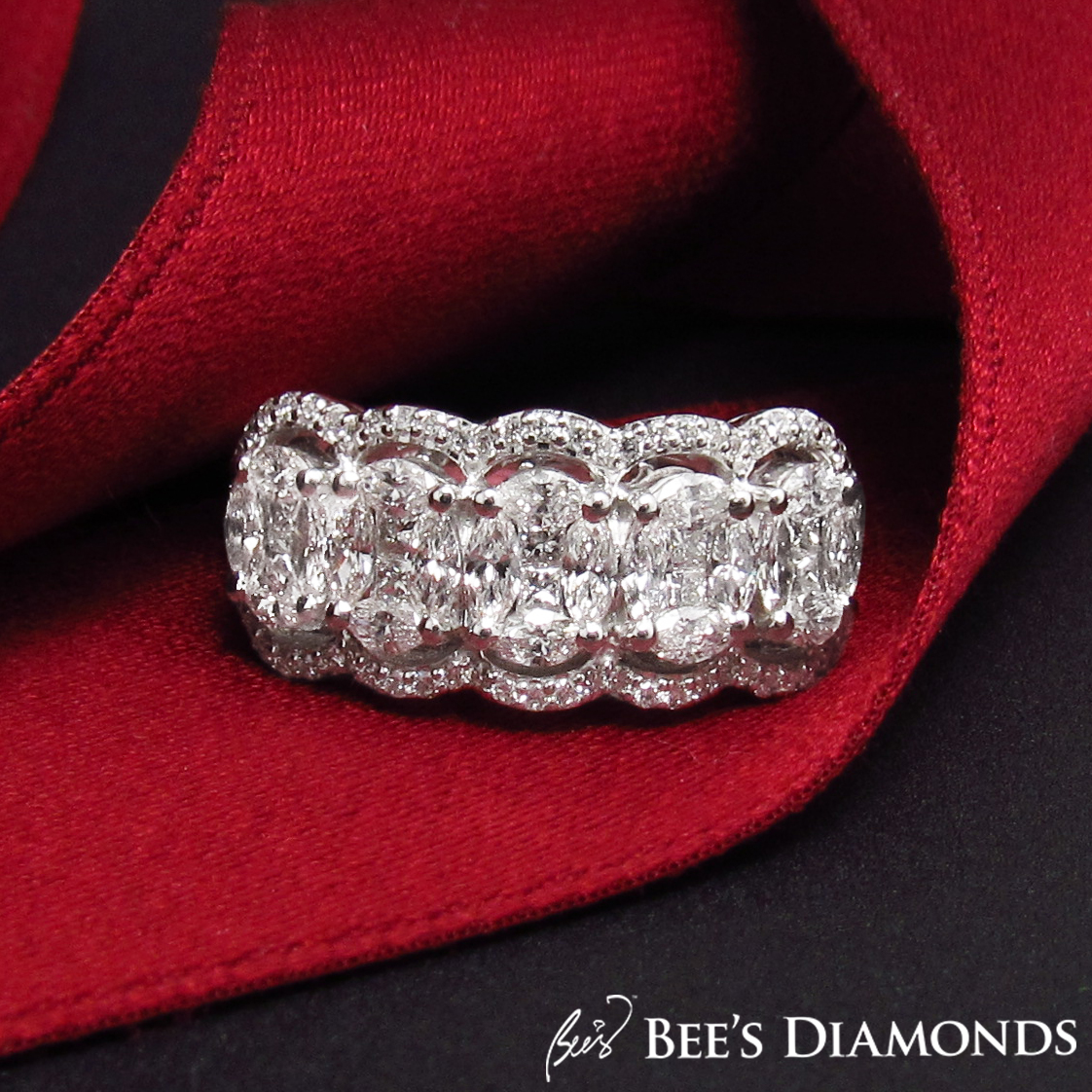 Invisible setting, oval diamond ring | Bee's Diamonds
