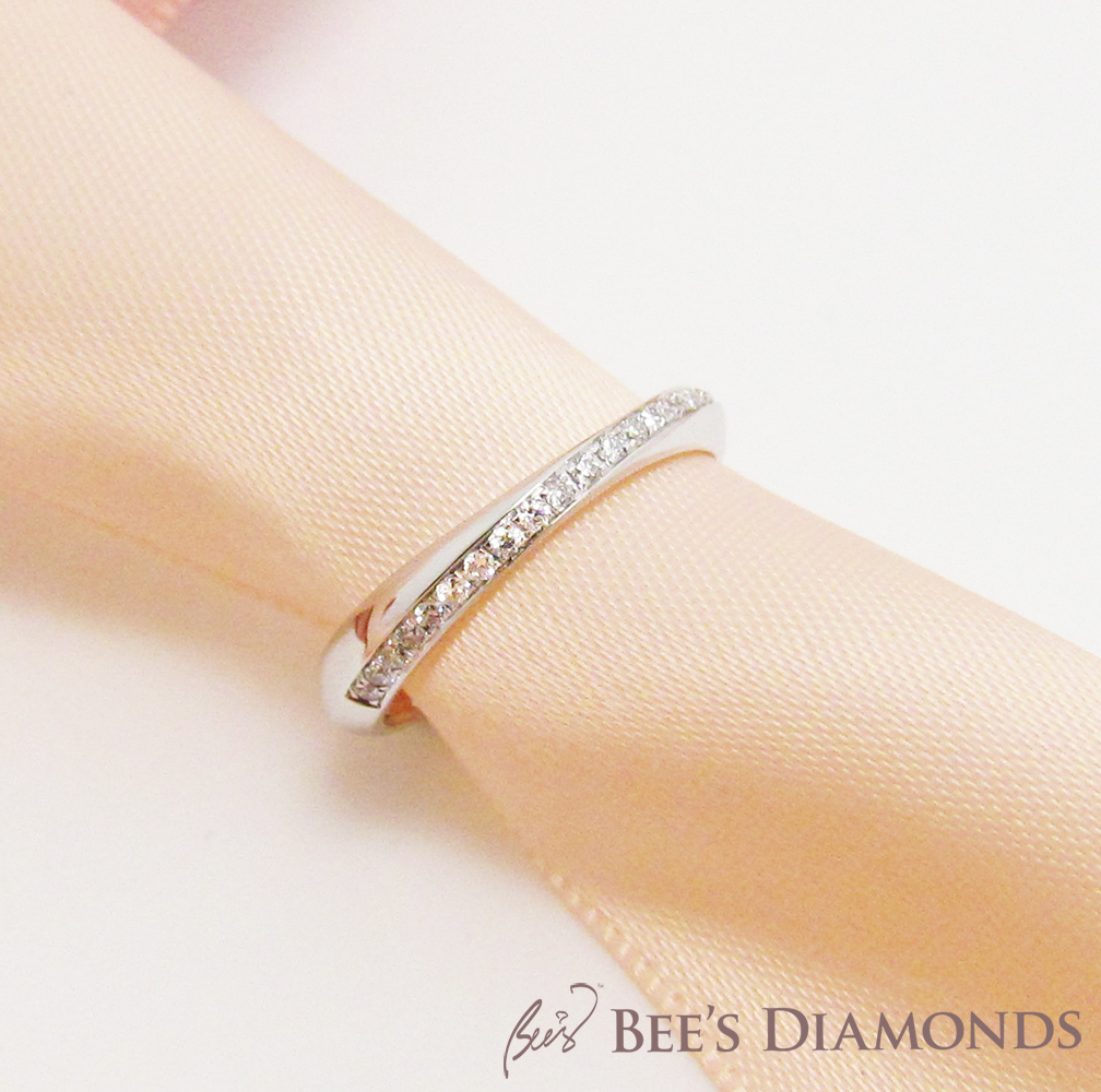 Mobius style diamond wedding ring